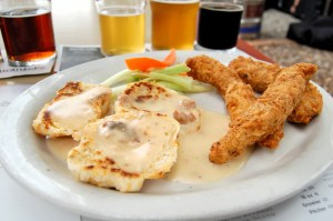 Fried chicken tenders, cheddar herb biscuits with country gravy. Photo by Rachel Dugas