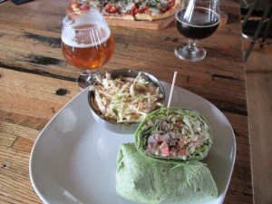 Quinoa Veggie Wrap: Quinoa, brussels-sprouts slaw, balsamic tomatoes, slivered almonds, goat cheese, butter lettuce, spinach tortilla, with a side of Apple-Chipotle Slaw & a Myrcenary from Odell Brewing