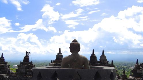 Seventy-two Buddhas sit on the top of Borobodur, watching the sunrise