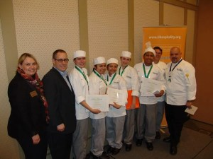 William M. Davies Career & Technical High School Culinary Team, from left to right order: Heather Singleton, Sr. VP, RIHEF; Jesse James, US Foods; Students: Maria Jacobo, Cesia Lapop, Osiris Hernandez, Elise Calhoun, and Reymy Pena; Chef Peter Fangiullo and Chef Santos Nieves, Culinary Teachers, Davies Career & Tech