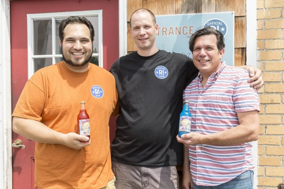 from left to right, Skepsis Multimedia graphic designer Mike Corsini, Yacht Club Bottling Works owner John Sgambato and cartoonist Frankie Galasso