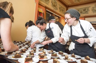 Plating dessert at the 2016 Eat Drink RI Festival Dinner by Dames, at center Chef Sara Reilly, at right Chef Melissa Denmark. Photo by Stacey Doyle Photography