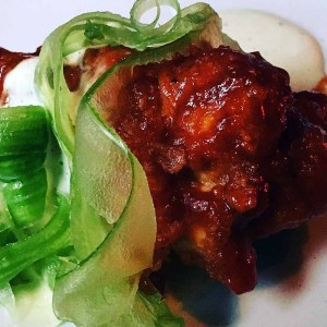 Spicy BBQ chicken wing with shaved celery. | Photo by Steve Coomes