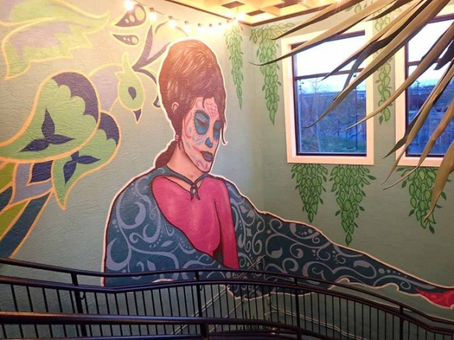 One of several hand-painted murals inside Doc's Cantina. | Photo by Steve Coomes