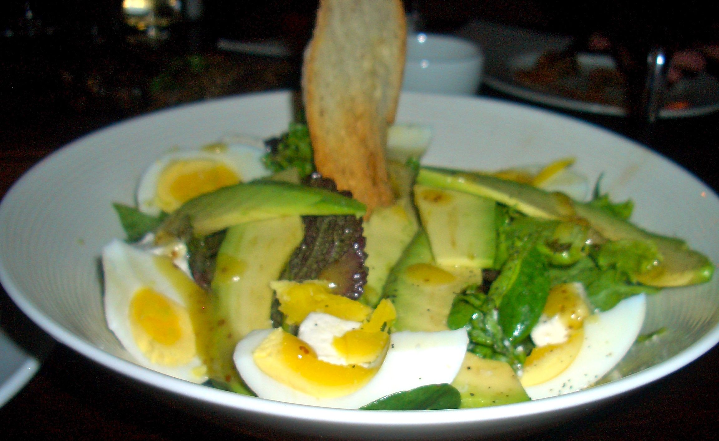 kloof street salad of avo feta and boiled egg with a honey mustard dressing aqua shard subdued lighting