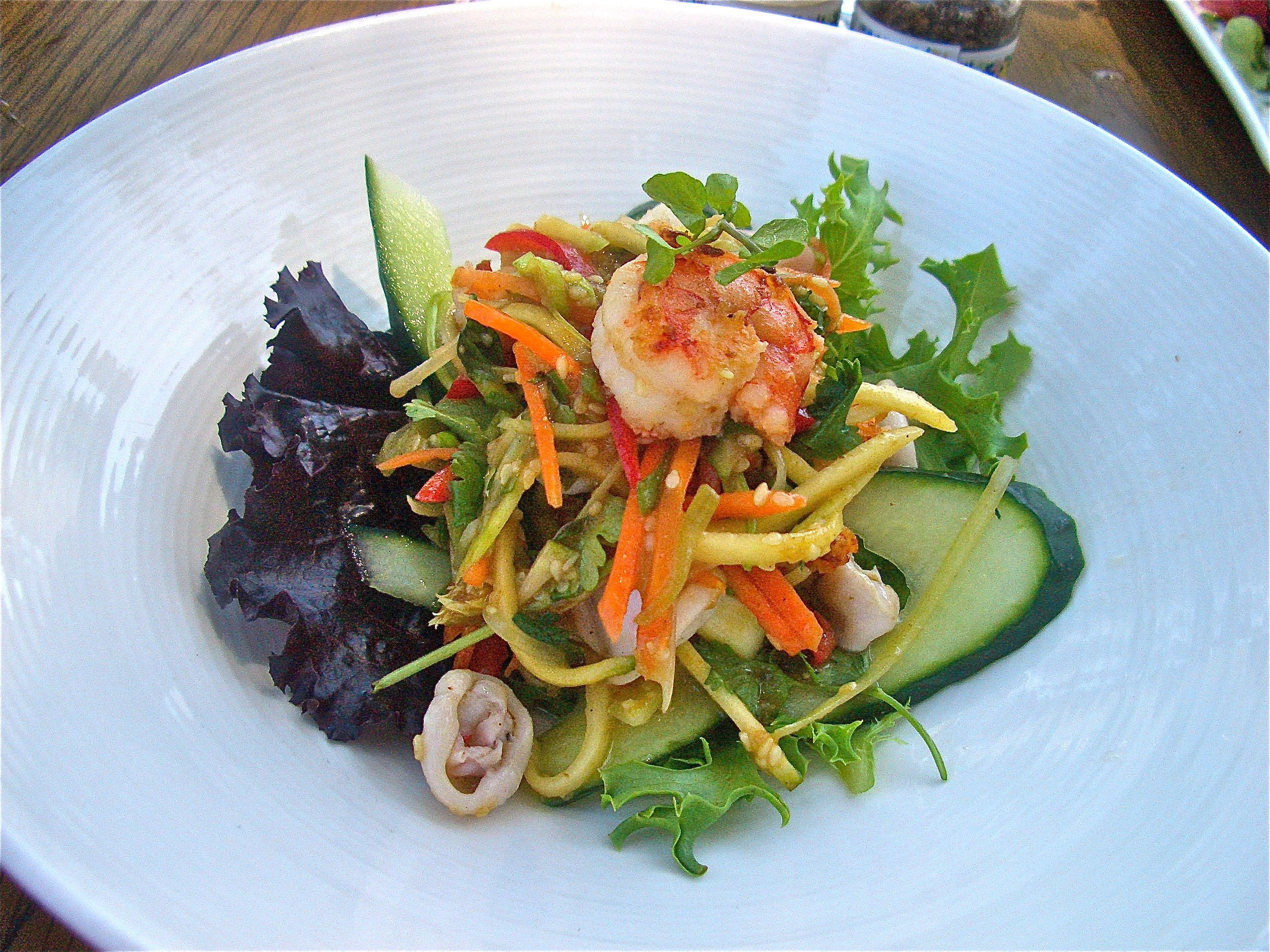 thai prawn and calamari salad with coriander mango and tamarind sesame dressing aqua shard subdued lighting