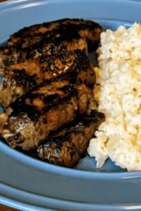 Steak strips with caulirice on a blue plate