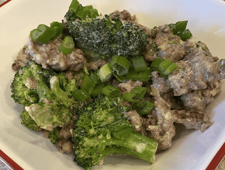 Keto broccoli and beef recipe in a white bowl