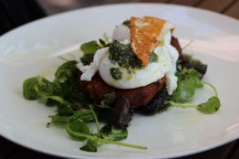 Sweet potato and caramelized onion fritters, poached eggs, thyme roast field mushrooms, snow pea shoots, grilled saganaki & truffled salsa verde