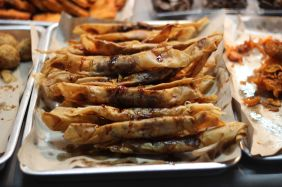 Deep fried bananas in spring roll wrappers with chocolate sauce