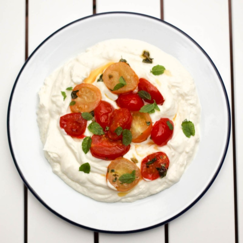 Whipped feta with roast tomatoes, oregano and mint