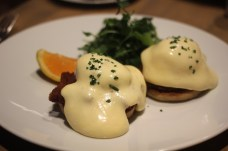 Poached eggs with smoked pork belly, cheddar sabayon and a homemade English muffin at L'Abbatoir