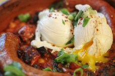 Brunch at Medina! Tajine (2 Poached Eggs, Spicy Merguez Sausage, Seasonal Vegetables Stew of Chickpeas, Black Olives & Preserved Lemon with Grilled Focaccia)