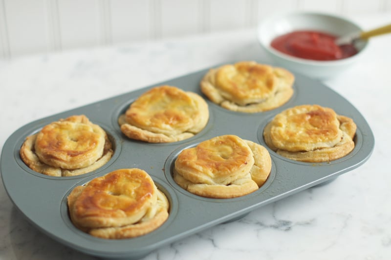 beef and guinness pies in muffin tin