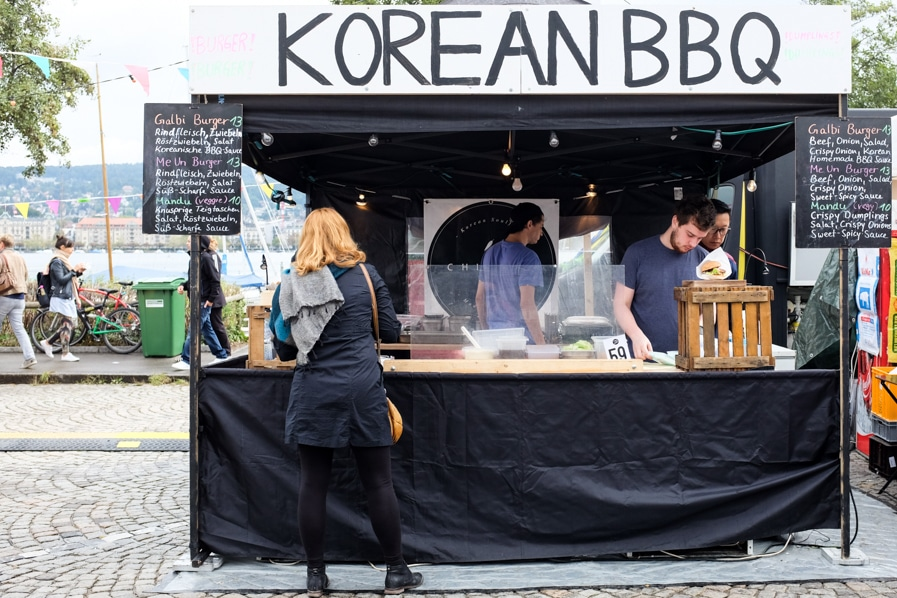 {The Korean BBQ stand with glimpses of the stunning Lake Zurich in the background.}