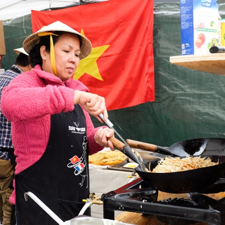 {Some wok action at the Restaurant Saigon stand.}