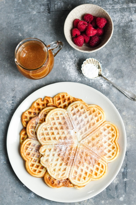 Waffles with Salted Caramel Sauce with bowl of raspberries