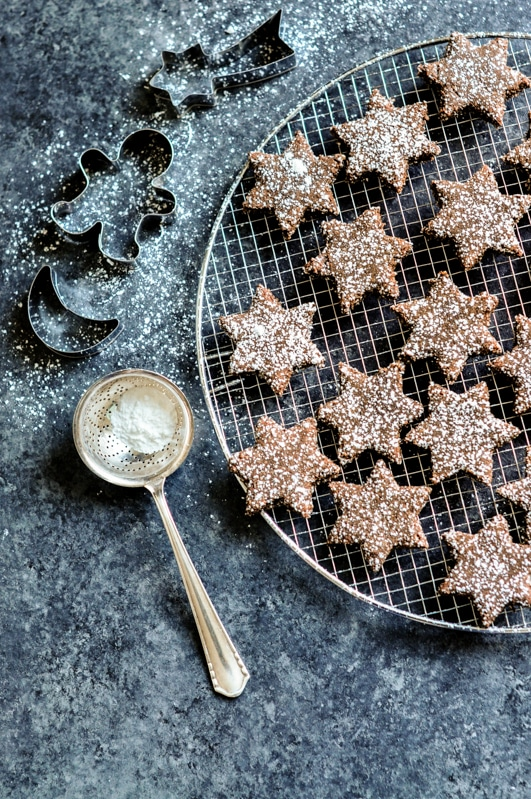 cinnamon chocolate star cookies zimtsterne with cookie cutters