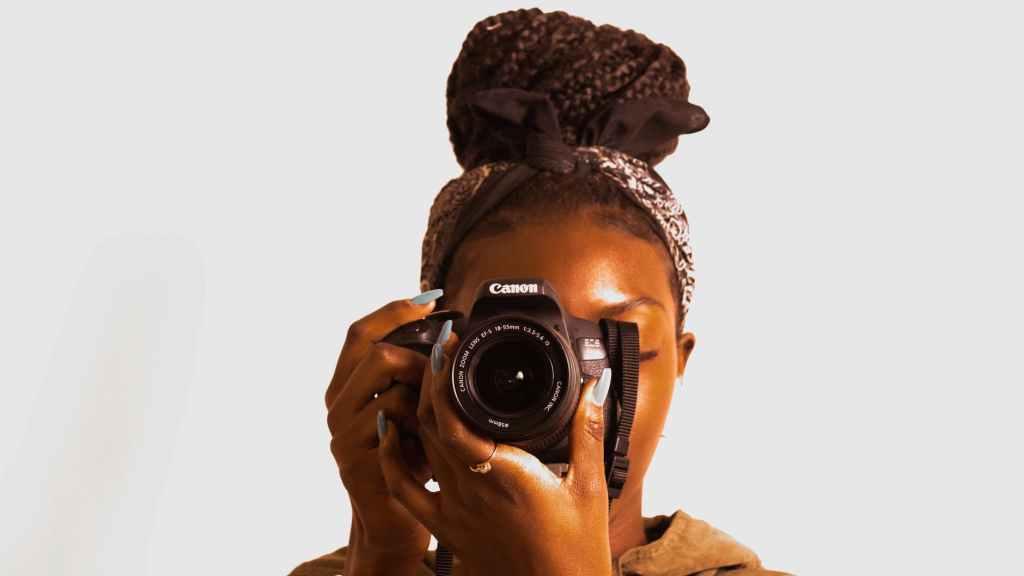 woman using canon dslr camera