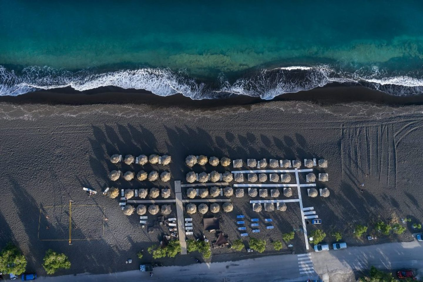 Perissa Beach, covered with black sand and one of the best beaches in Santorini