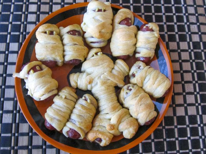 mummy dogs on orange plate