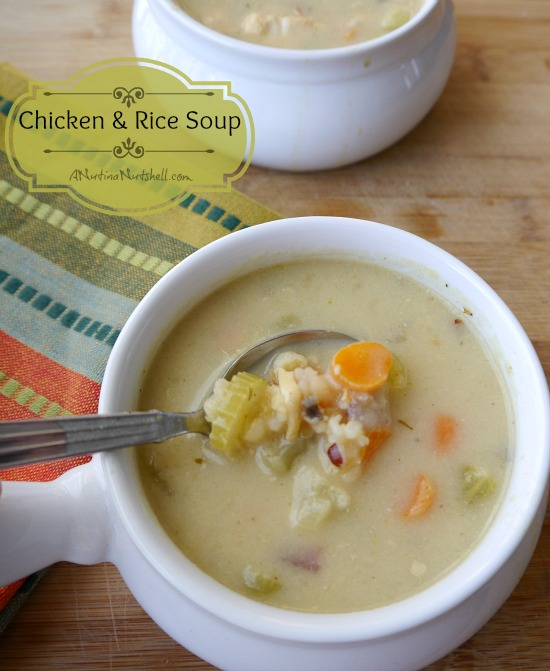A bowl of soup and a spoon on a table, with Chicken and Noodle