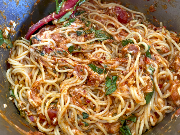 mixed ingredients for spicy spaghetti pie