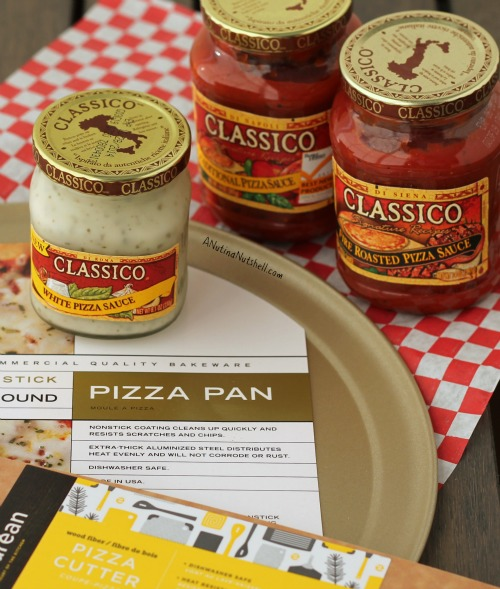 jars of classico pizza sauce and pizza pan