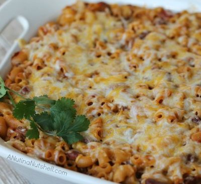A dish is filled with food, with Casserole cheesy chili mac casserole