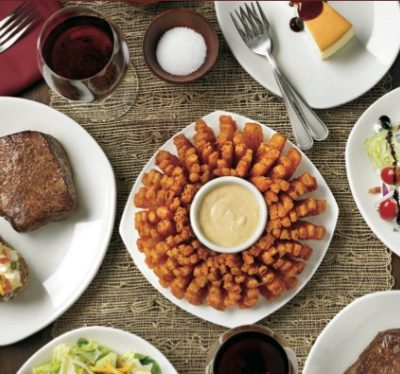 A plate of food on a table, with Steak