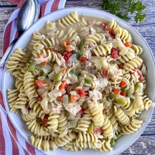 creamy cajun chicken pasta in serving bowl