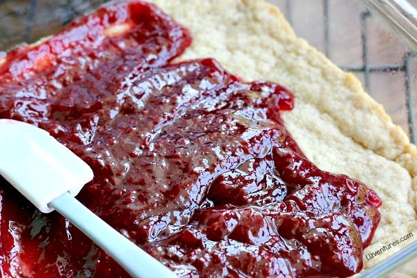 spread raspberry filling over crust