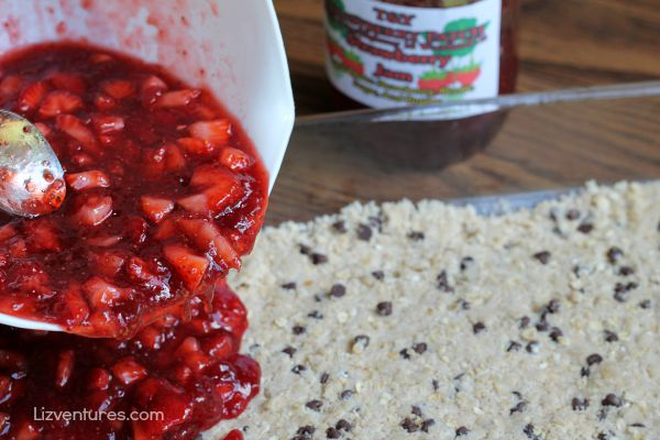 spread strawberry preserve mixture over strawberry chocolate chip crumble bars