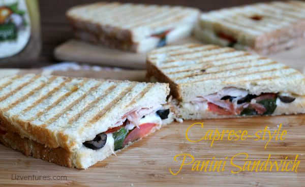 Caprese-style Panini Sandwich with black olives and ham