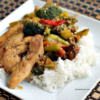 A plate of food with rice meat and vegetables, with Chicken