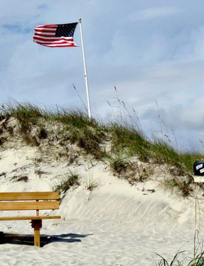 An empty park bench on the beach