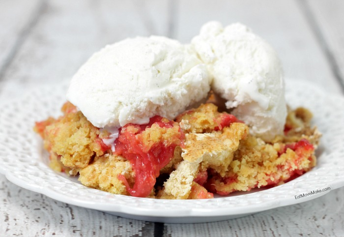 serving of rhubarb dump cake on plate with ice cream