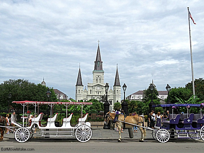 A group of people riding on the back of a horse drawn carriage