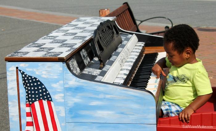 little-boy-playing-piano-banner-elk-nc-public-art