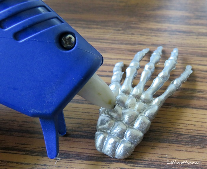apply-hot-glue-to-skeleton-hands