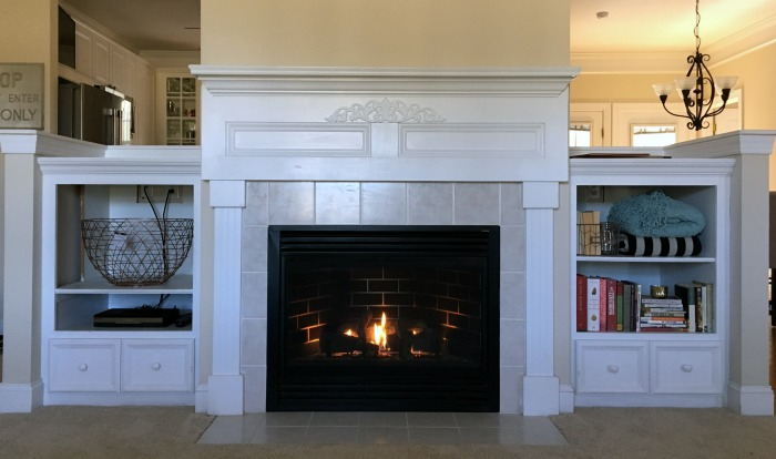 Styled deep bookshelves fireplace
