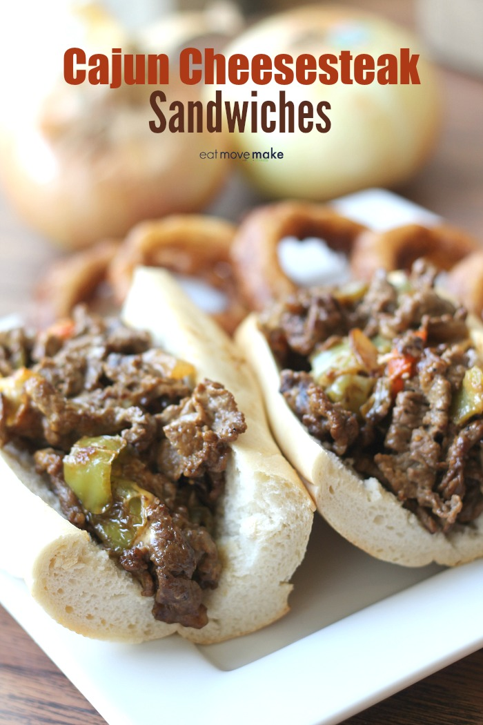 Cajun Cheesesteak Sandwiches on plate with onion rings