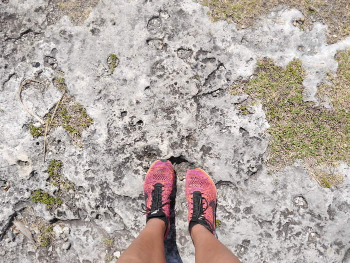 feet standing on rocky ground