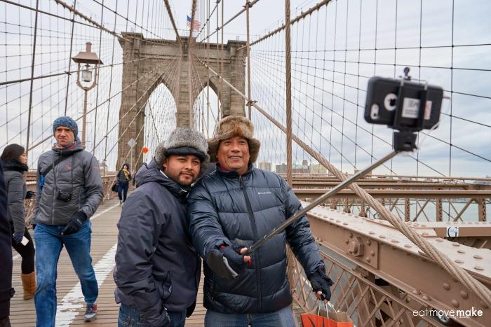 tourists using a selfie stick