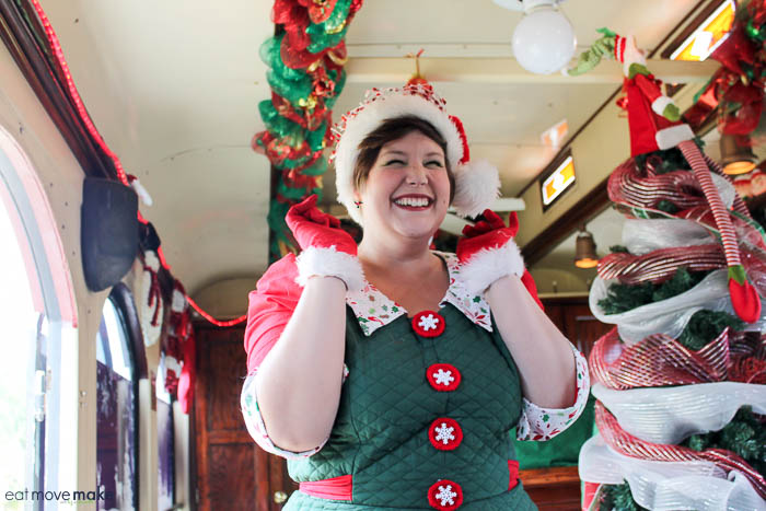 A woman wearing a costume, with North Pole Express