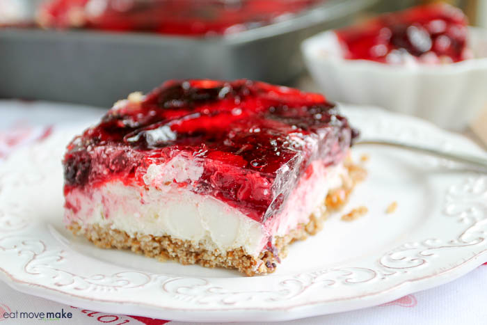 A close up of a piece of cake on a plate, with Raspberry