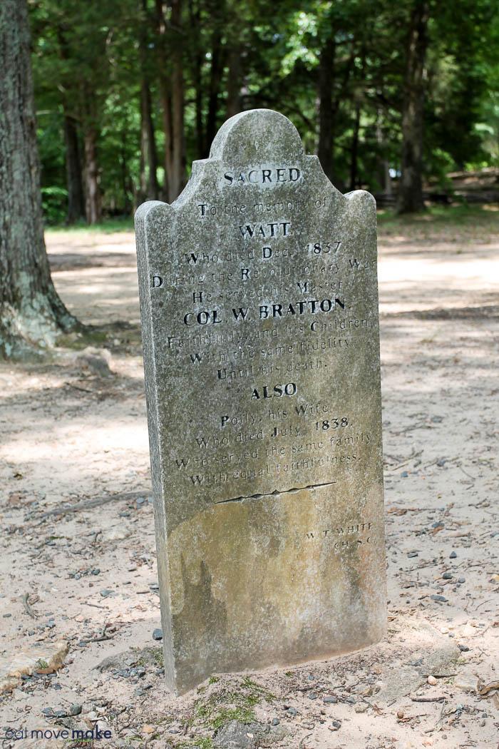 A gravestone in a park