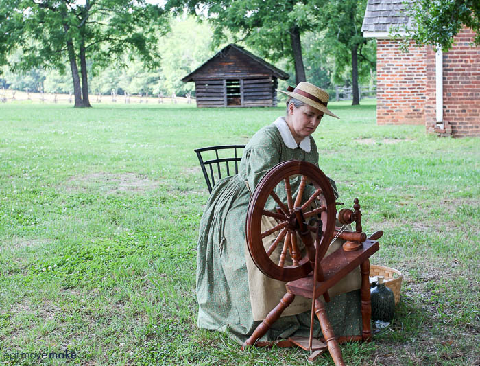 A person using a spinning wheel