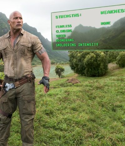 Dwayne Johnson standing in front of a green field
