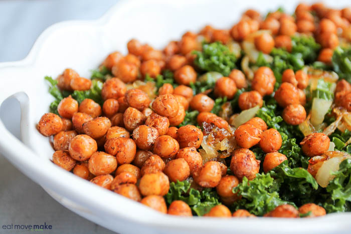 Mustard-Marinated Kale Salad with caramelized onion and spicy chickpeas in dish